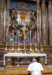 File photo of Pope Francis praying in front of Marian icon in Basilica of St. Mary Major in Rome