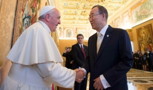 Pope Francis shakes hands with U.N. Secretary General Ban during a meeting at the Vatican
