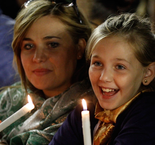 Luisana Puocci and Elise Natale, 10, attend an Oct. 4 prayer vigil led by Pope Francis for the extraordinary Synod of Bishops on the family in St. Peter's Square at the Vatican. (CNS/Paul Haring)